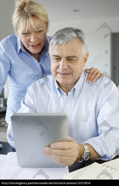 senior, couple, looking, at, bank, account - 12512016