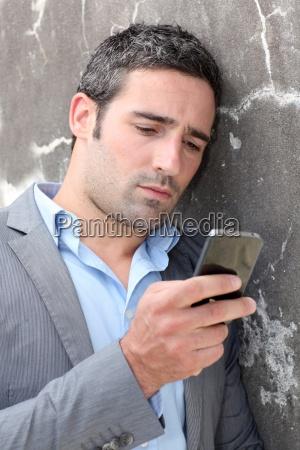 businessman, talking, on, mobile, phone, against - 12513778