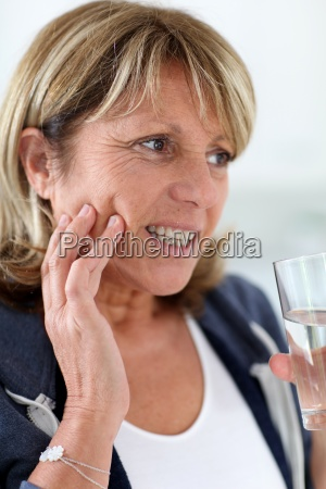 closeup of senior woman having toothache