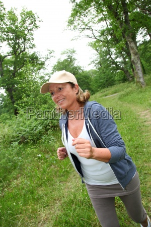 senior, woman, jogging, in, forest - 12514630