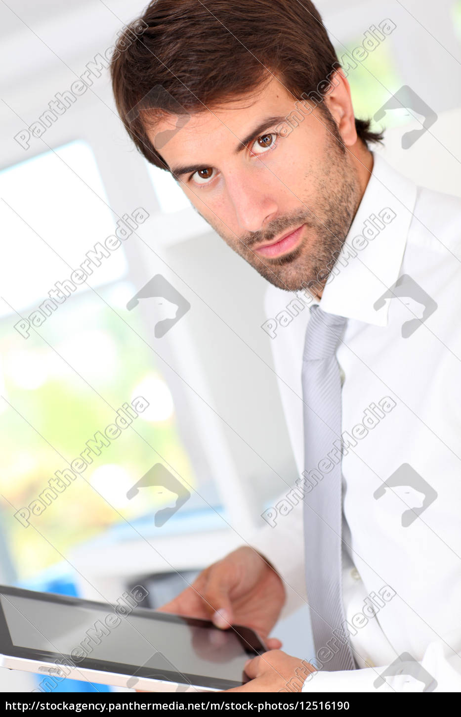 portrait, of, businessman, in, office, using - 12516190
