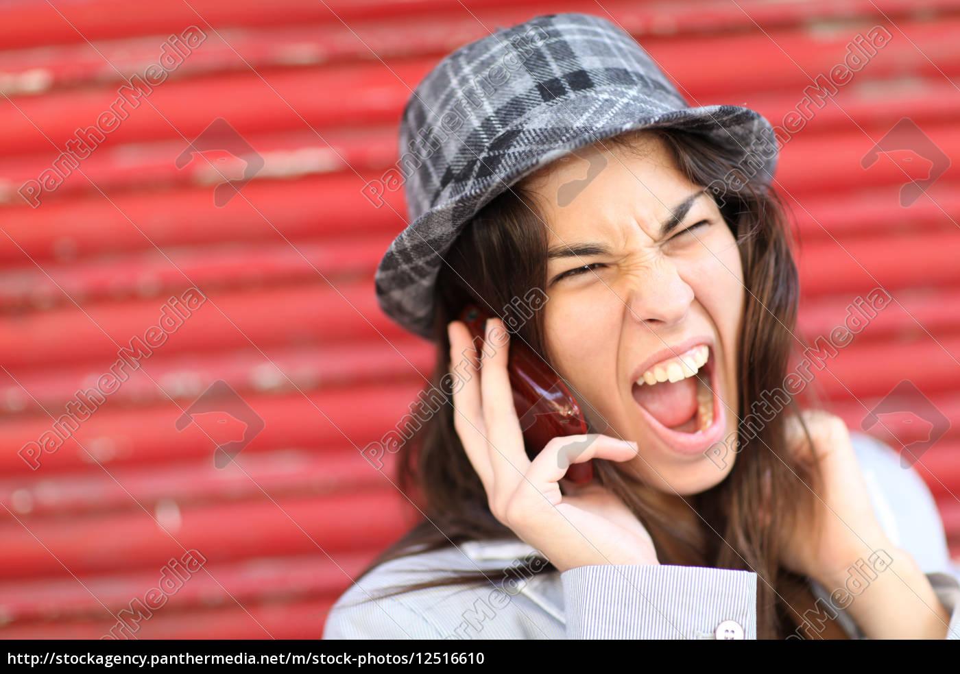 portrait, of, trendy, girl, shouting, on - 12516610