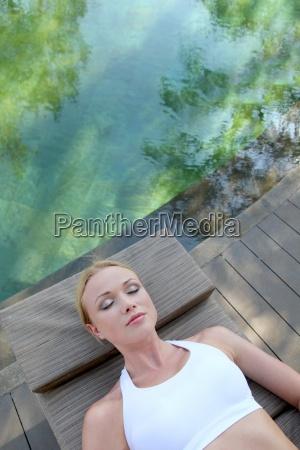 portrait of woman relaxing in deck