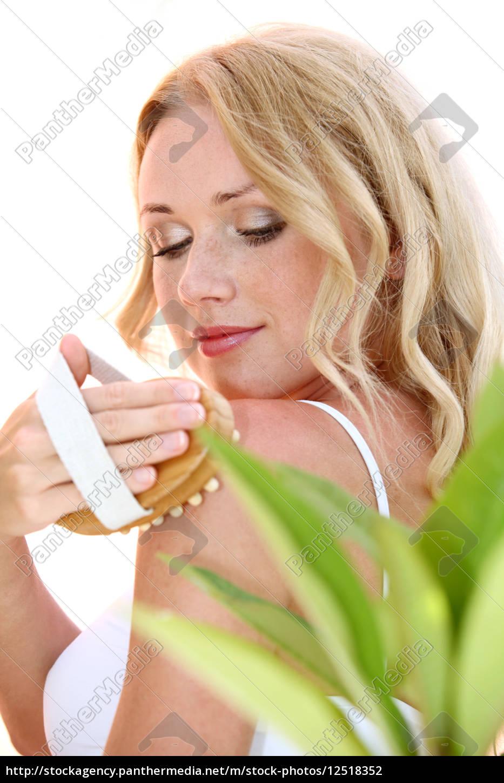 beautiful, blond, woman, using, massage, brush - 12518352