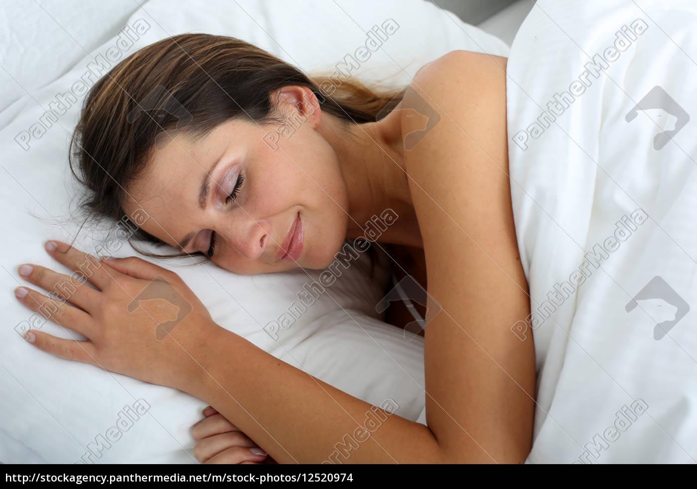 woman, feeling, good, asleep, in, bed - 12520974
