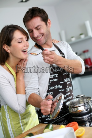 man preparing dinner and making her