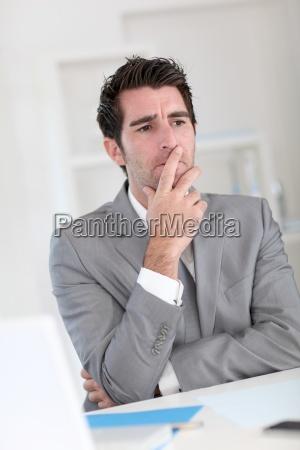 businessman, with, doubtful, look - 12521876