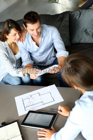 couple, meeting, consultant, for, financial, contract - 12521238