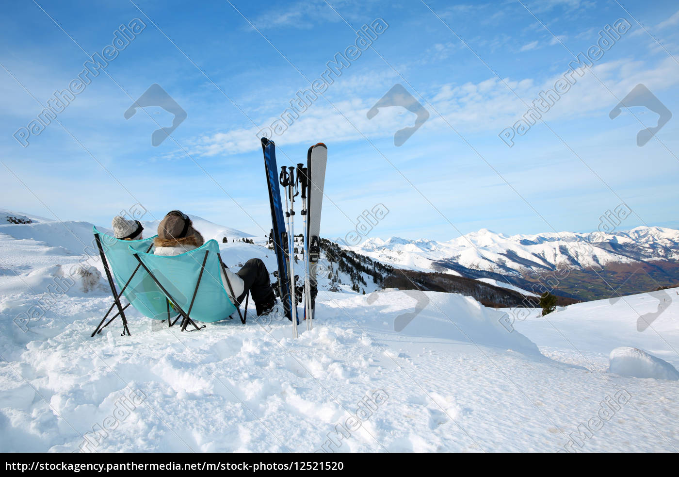 couple, of, skiers, relaxing, in, long - 12521520