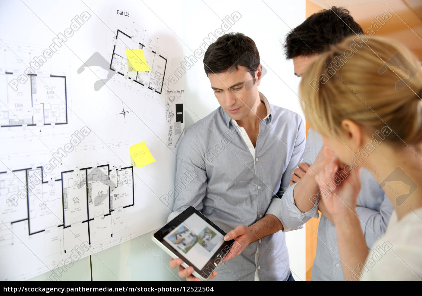 architects, in, office, looking, at, construction - 12522504