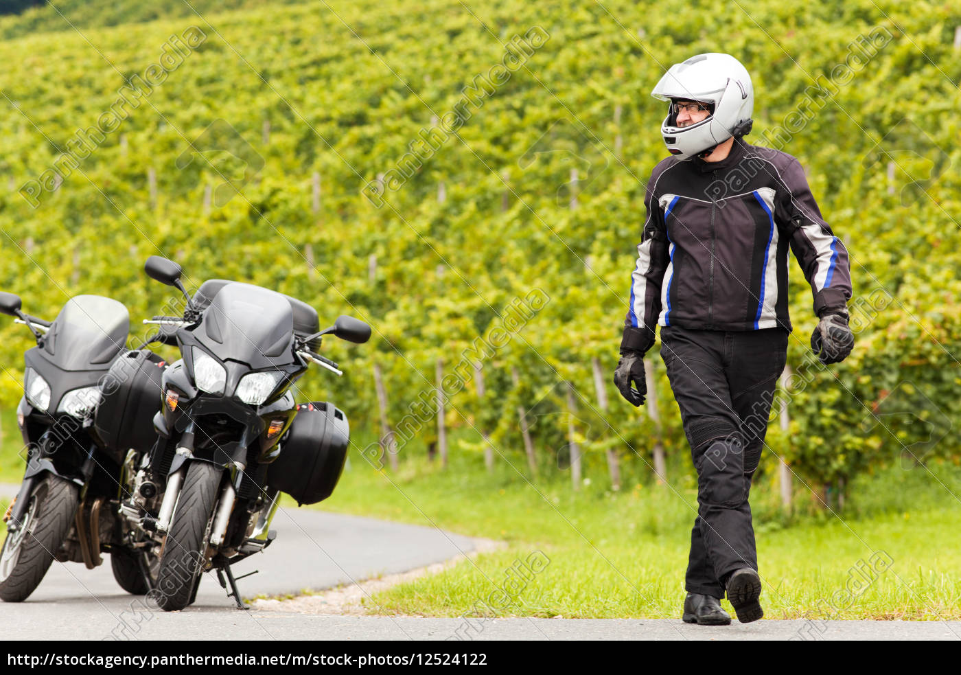 motorcyclist, with, a, helmet, goes, on - 12524122