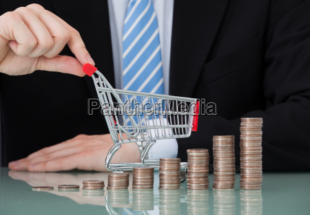 businessman with shopping cart and coin