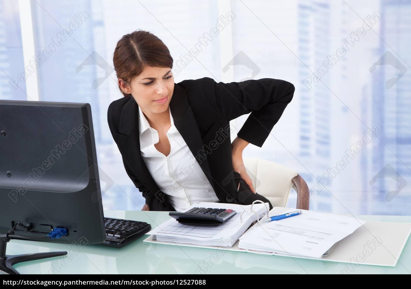 tired, businesswoman, suffering, from, backache - 12527088