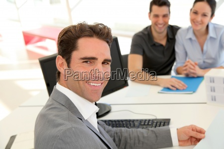 couple in real estate agency signing