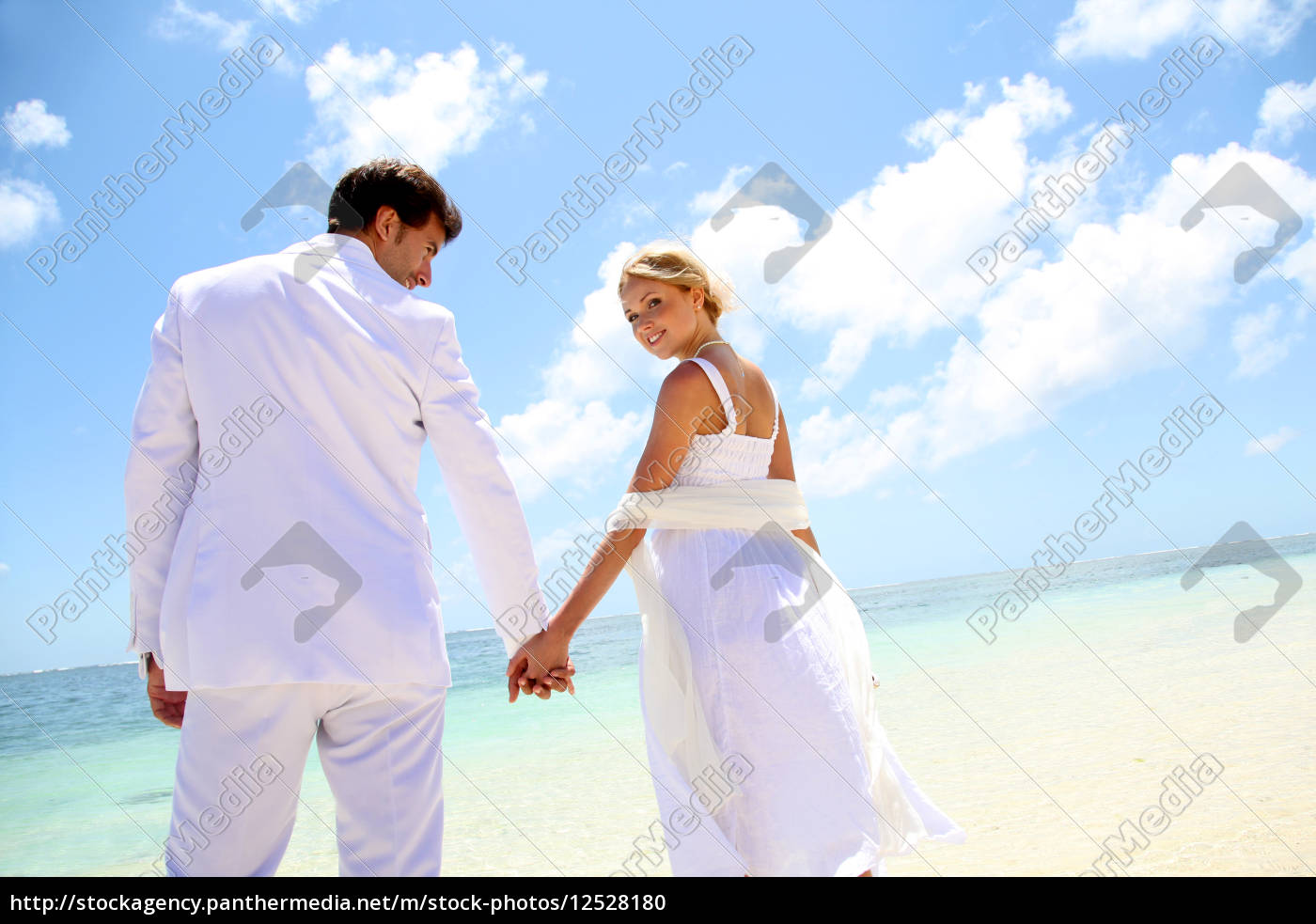 just-married, couple, standing, by, blue, lagoon - 12528180