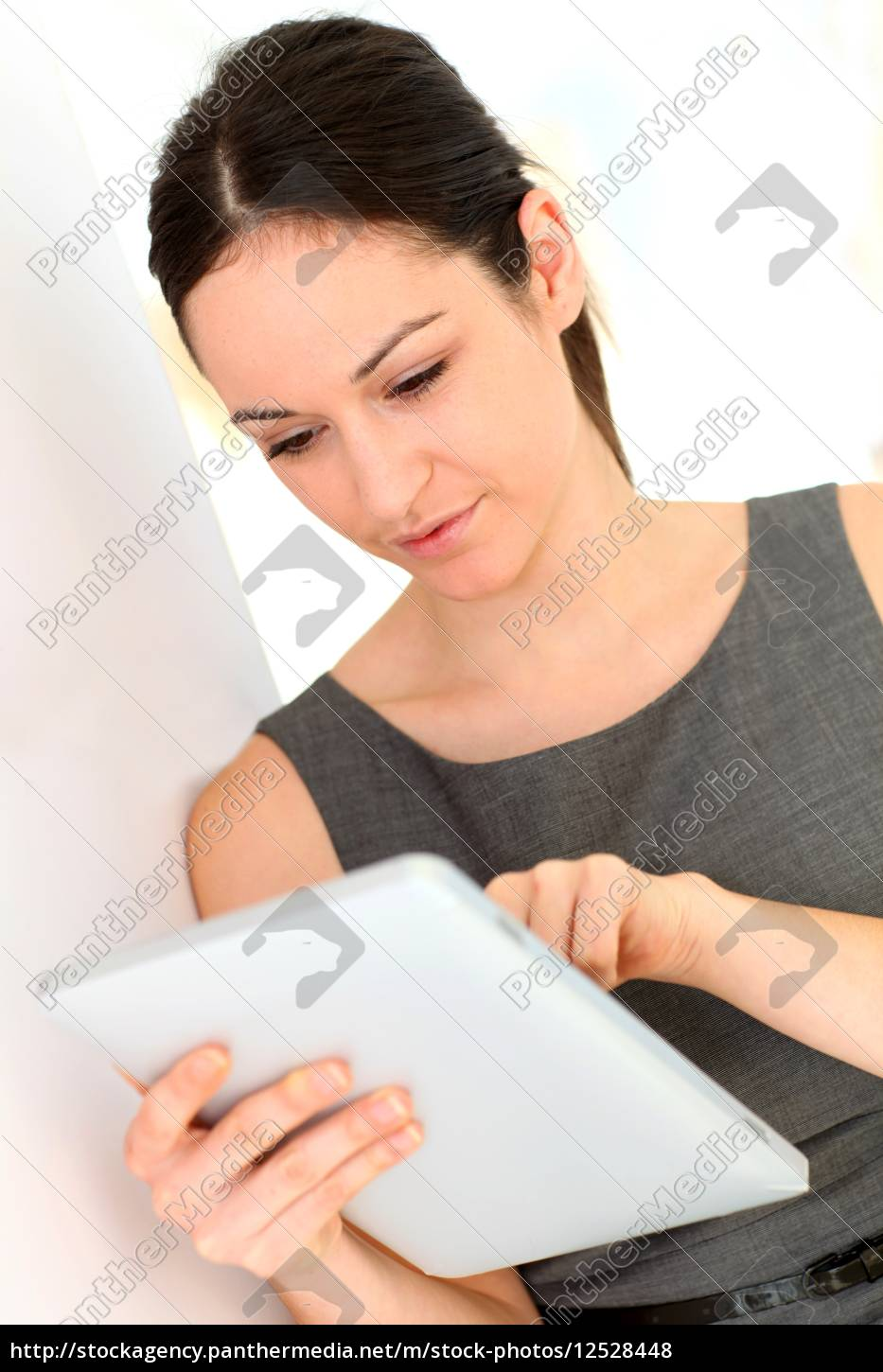 young, businesswoman, using, electronic, tablet - 12528448