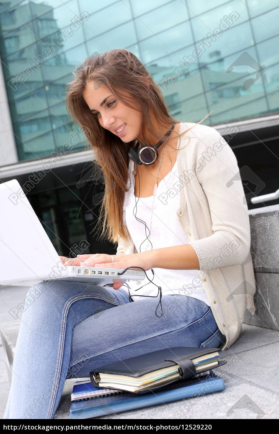 young, girl, at, university, using, laptop - 12529220