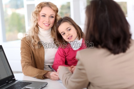 woman in real estate agency with