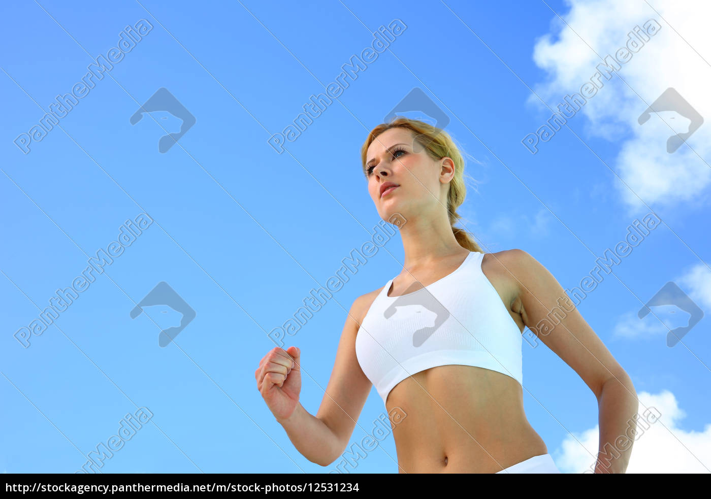 blond, woman, jogging, outside, on, a - 12531234