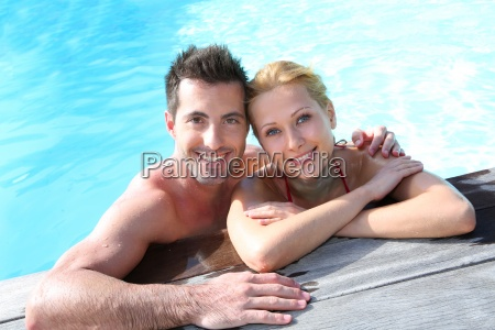cheerful, couple, relaxing, in, swimming, pool - 12531464