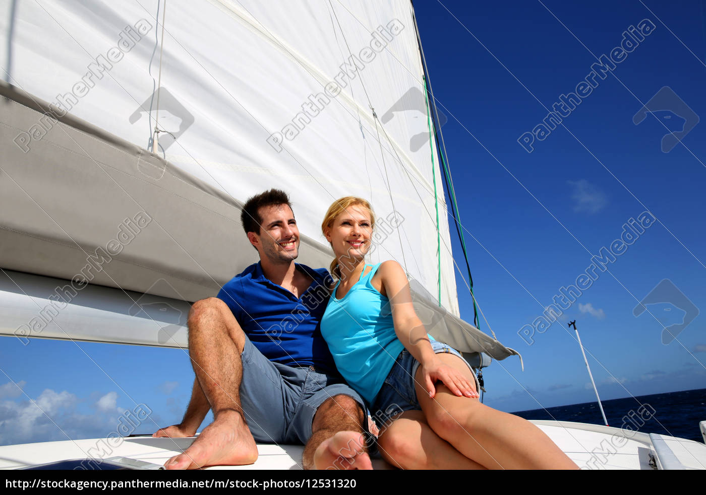 portrait, of, couple, sitting, on, the - 12531320