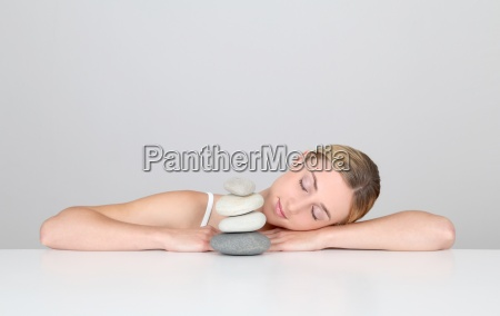 woman resting with eyes shut by