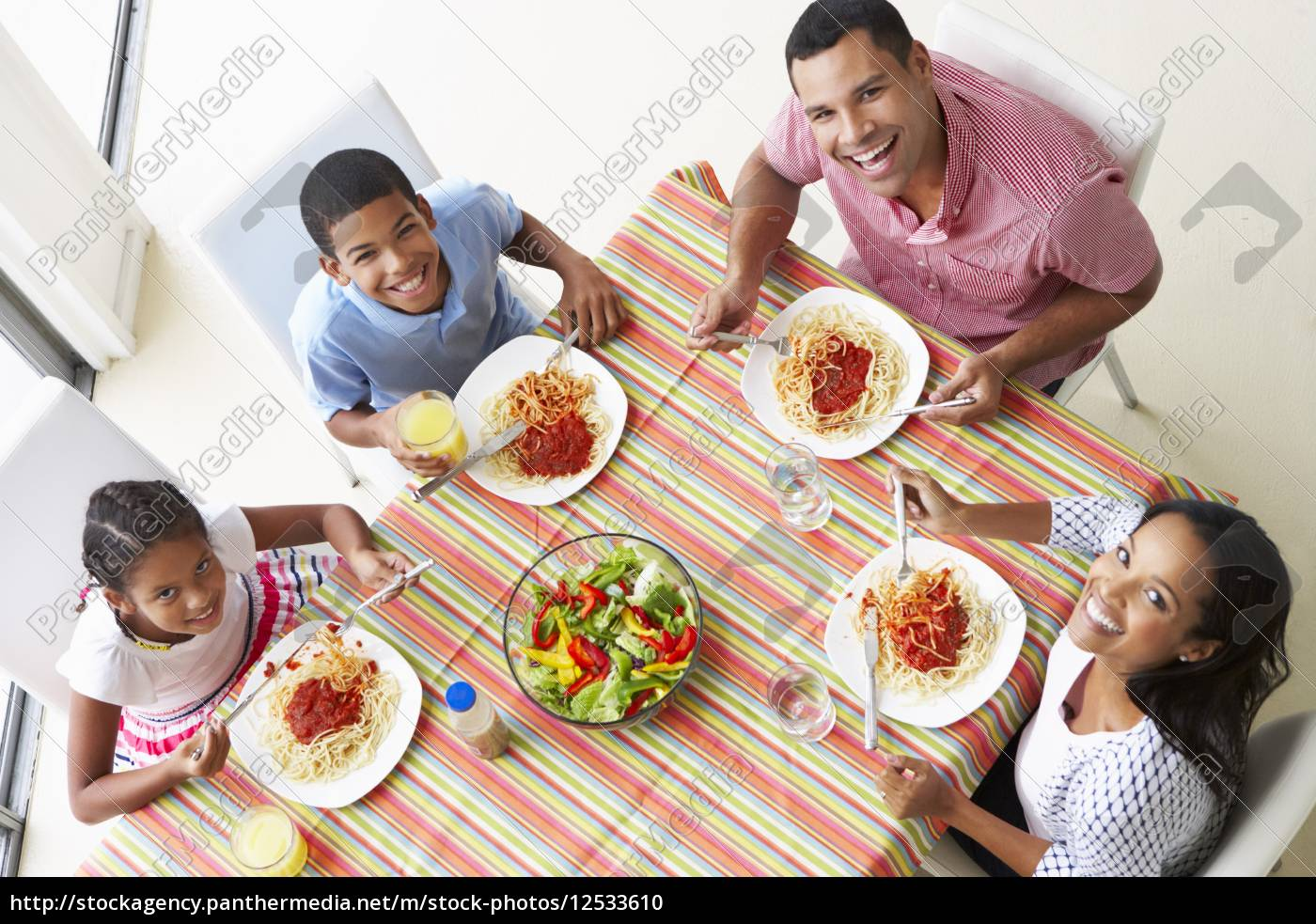overhead, view, of, family, eating, meal - 12533610