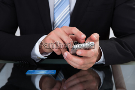 businessman sending a text message or