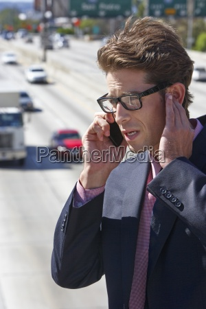 businessman speaking on mobile phone by