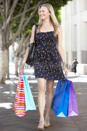 woman, carrying, shopping, bags, on, city - 12534794