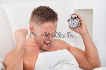 man screaming in frustration at his