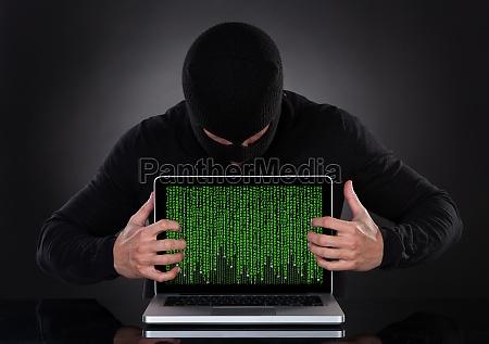 hacker stealing data of a laptop