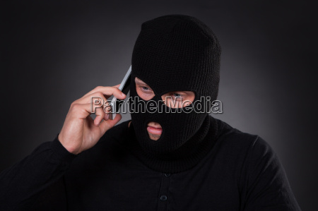 thief using a stolen mobile phone