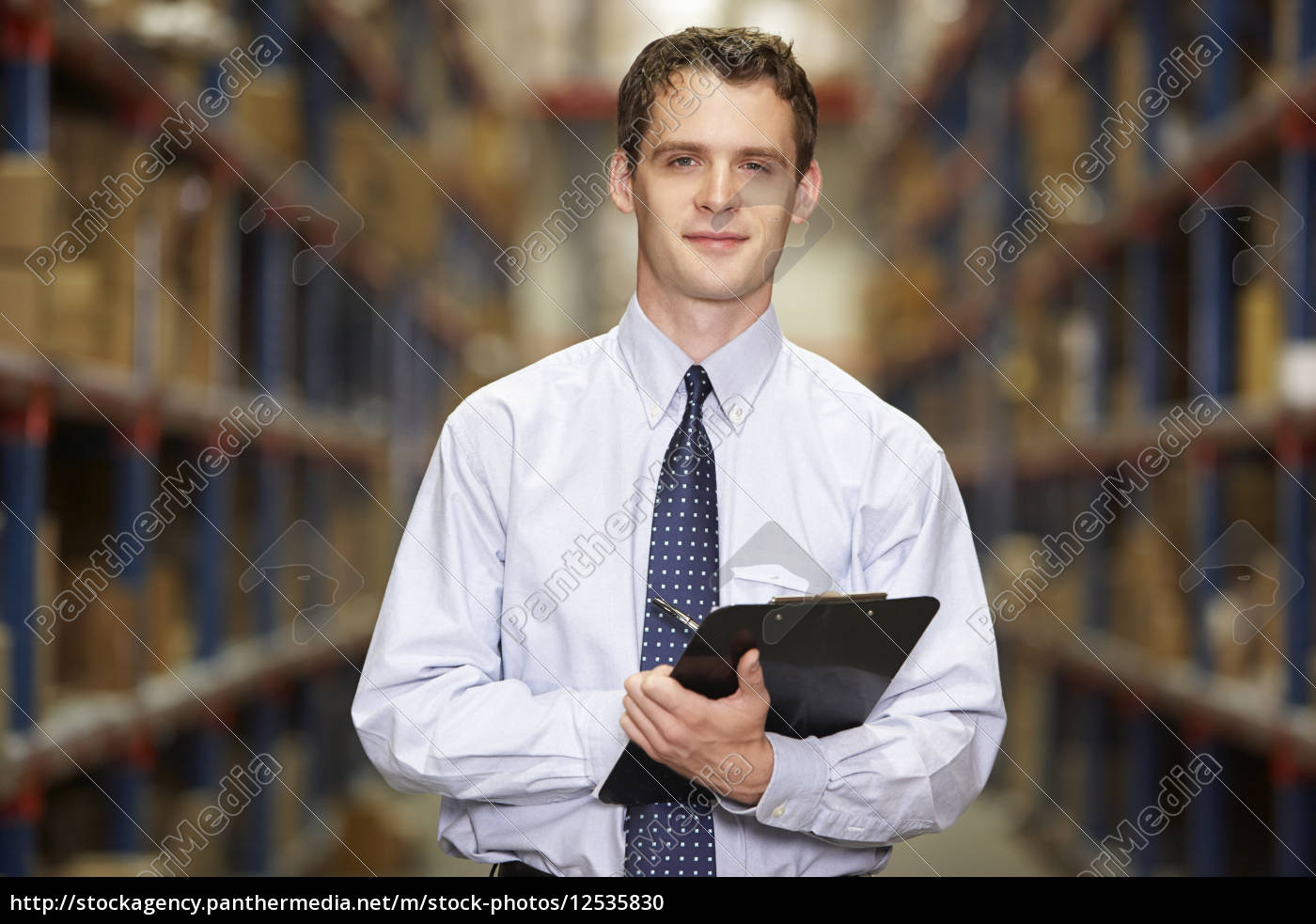 portrait, of, manager, in, warehouse, with - 12535830