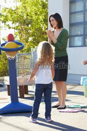 teacher, supervising, breaktime, at, elementary, school - 12535862