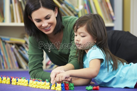 elementary, pupil, counting, with, teacher, in - 12536016
