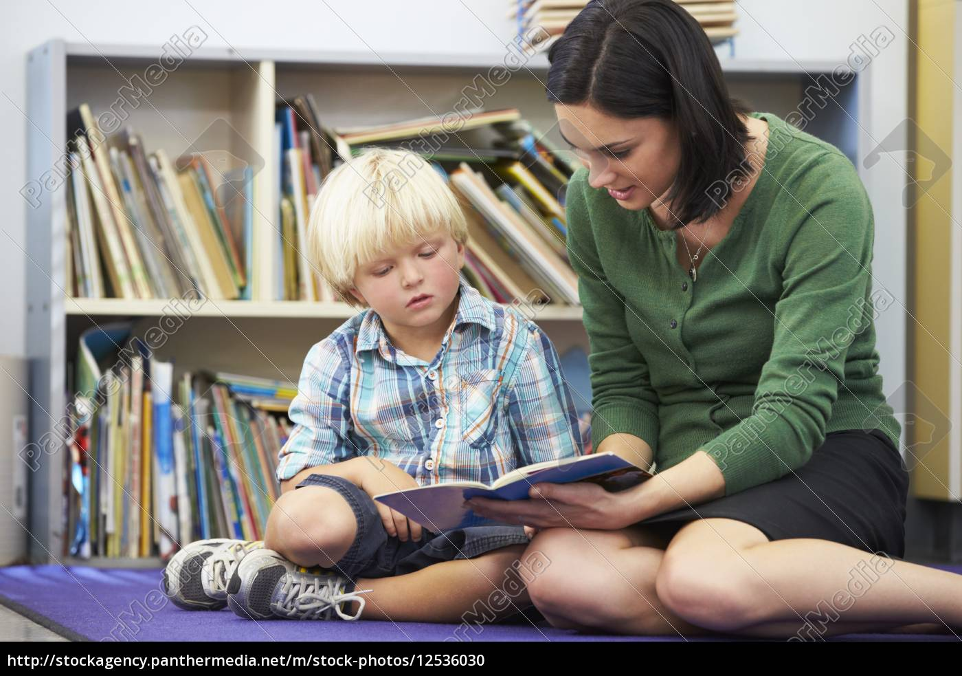 elementary, pupil, reading, with, teacher, in - 12536030