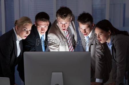 surprised, business, people, looking, at, computer - 12536148
