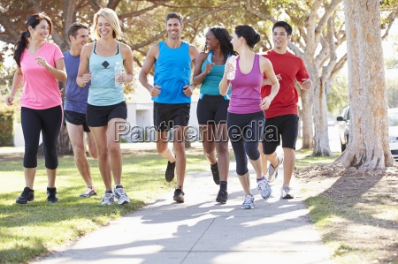 group of runners on suburban street