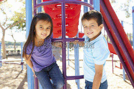 boy, and, girl, on, climbing, frame - 12537560