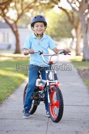boy, wearing, safety, helmet, riding, bike - 12537474
