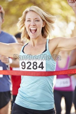 female, runner, winning, marathon - 12537224