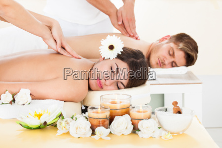 couple receiving massage at spa