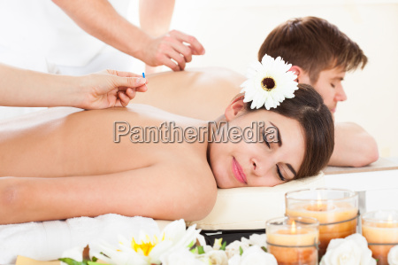 happy woman undergoing acupuncture