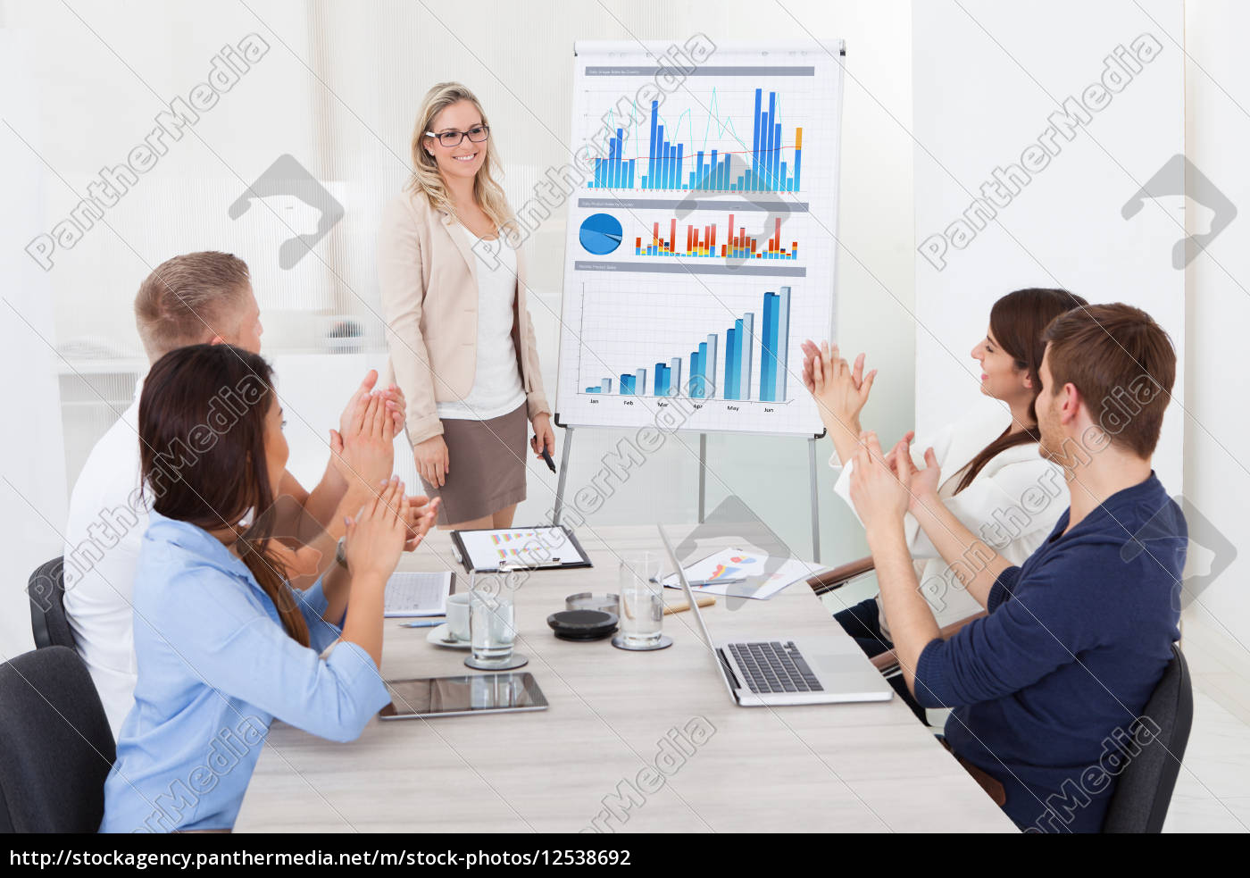 businesspeople, clapping, for, female, colleague, after - 12538692