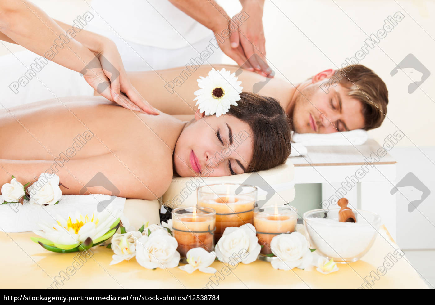 couple, receiving, massage, at, spa - 12538784