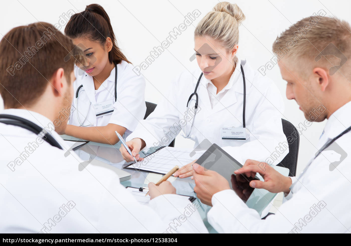 doctors, working, at, desk - 12538304