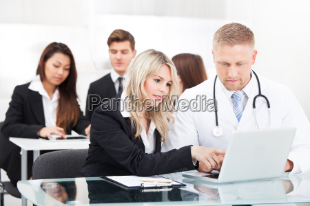 male, doctor, and, businesswoman, with, laptop - 12538152