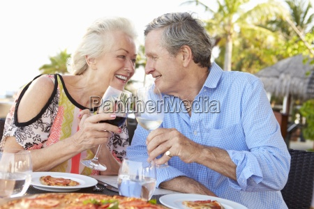 senior, couple, enjoying, meal, in, outdoor - 12538158