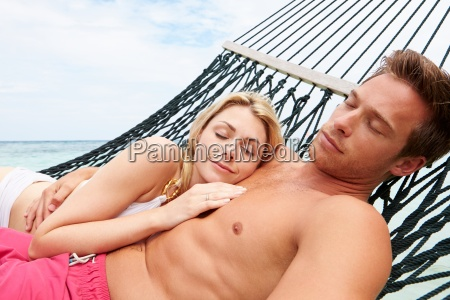 couple, relaxing, in, beach, hammock - 12539524